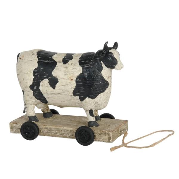 Kuh auf Rädern gefleckt